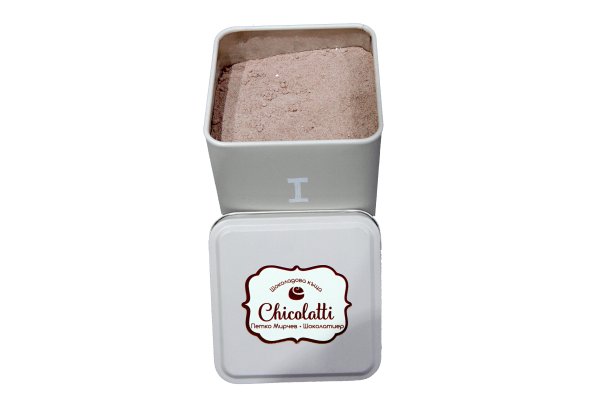 hot chocolate powder in a tin box